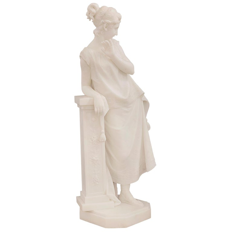 An exceptional Italian 19th century white Carrara marble statue of a beautiful maiden, signed F. Vichi. The statue is raised by a fine octagonal base with a decorative mottled border and wonderfully executed ground like design. The elegant and