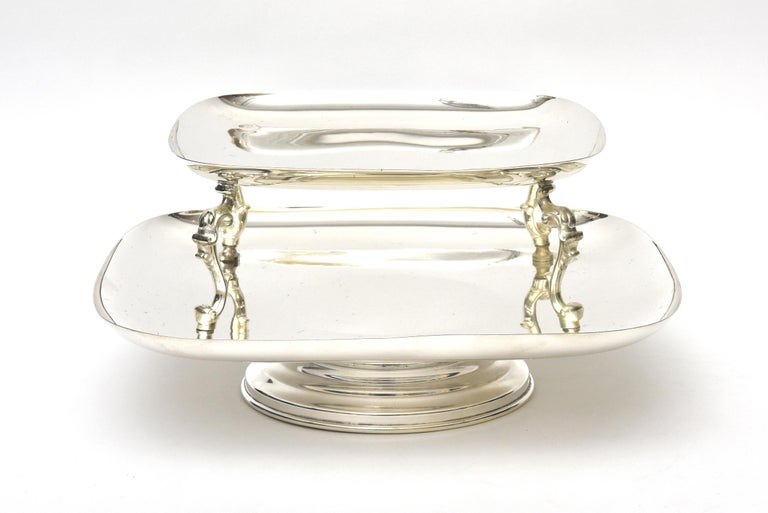 This large and modern looking 2-tiered serving caddy or serving piece swivels. The weight is good and solid. It is 7 inches to the top and between the two trays it is 4