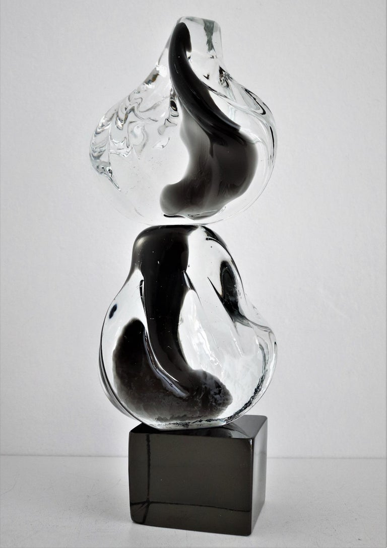 Beautiful and big, very heavy modern abstract sculpture made and signed by Livio Seguso. Made in Murano in the 1970s. The glass sculpture is made of Murano glass in shiny transparent glass with dark effects inside, as well as a dark glass