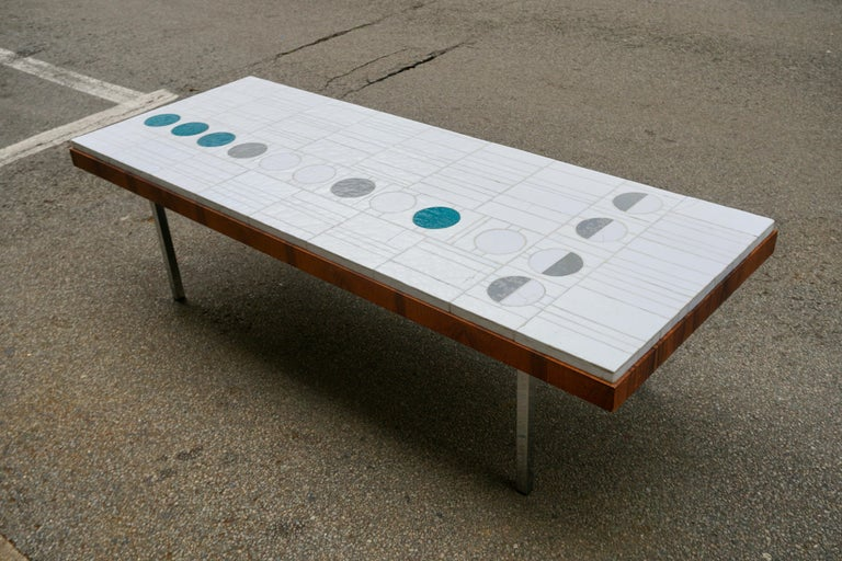 Rectangular white abstract ceramic coffee table on four chrome legs. This table is not signed but made in the style of Pia Manu.  Dimensions; Width 161 cm. depth 61 cm. Height 45 cm. Thickness of the table top 7 cm. Weight 23 kg.