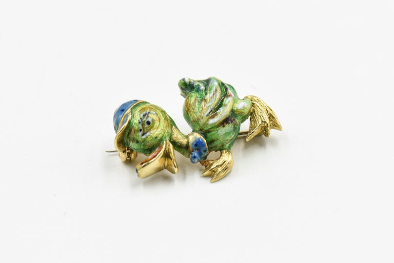 This little guy is just so cute.  He is 18k yellow gold and enamel.  He has a cute little blue cap with black polka dots and a matching bow around his neck.
