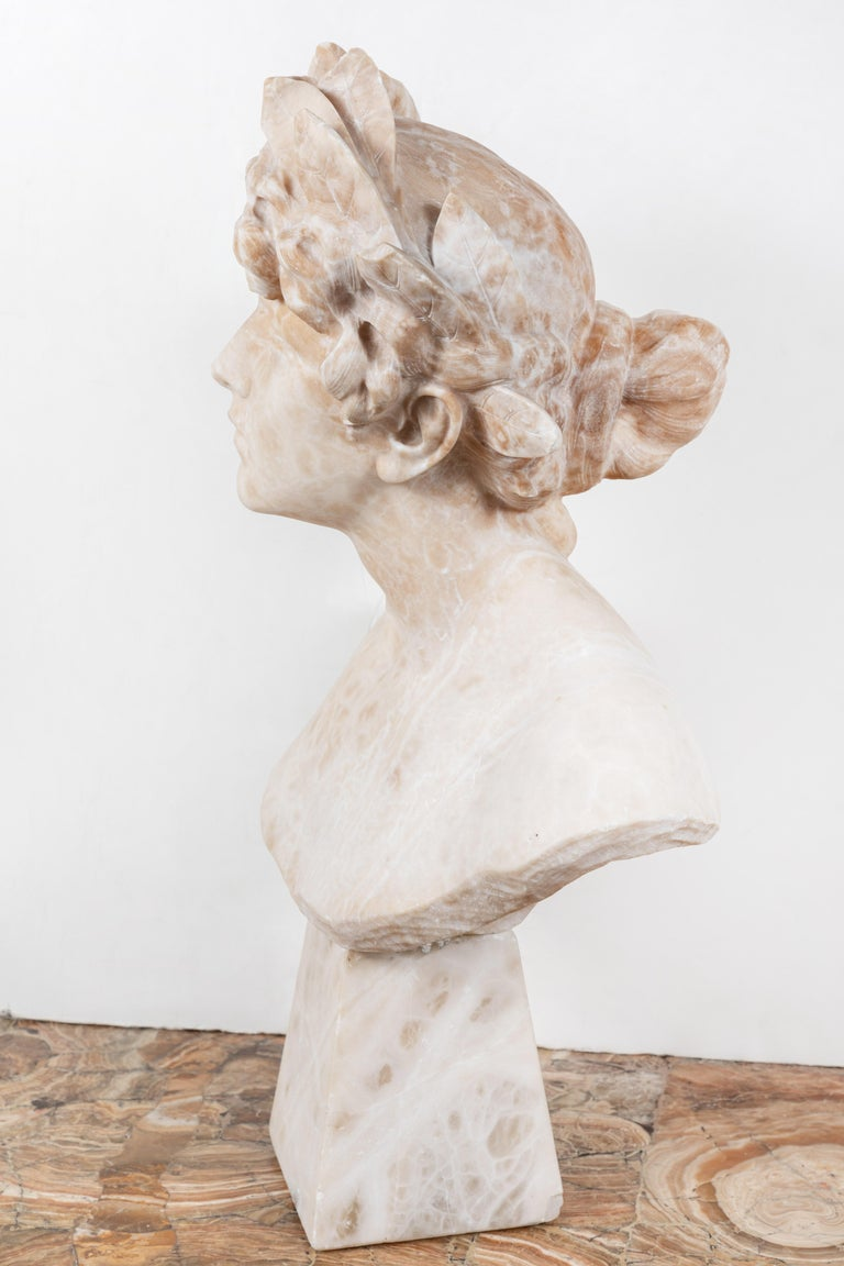 Beautifully carved, mounted, Liberty Period alabaster bust- an allegory of victory. The female figure featuring an elegant gaze. Her richly curled and bound hair is surmounted by a thick crown of laurels.
