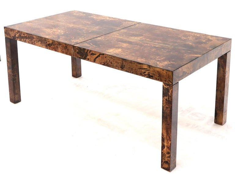 Mid-Century Modern lacquered parchment dining table by Aldo Tura. One 21.5