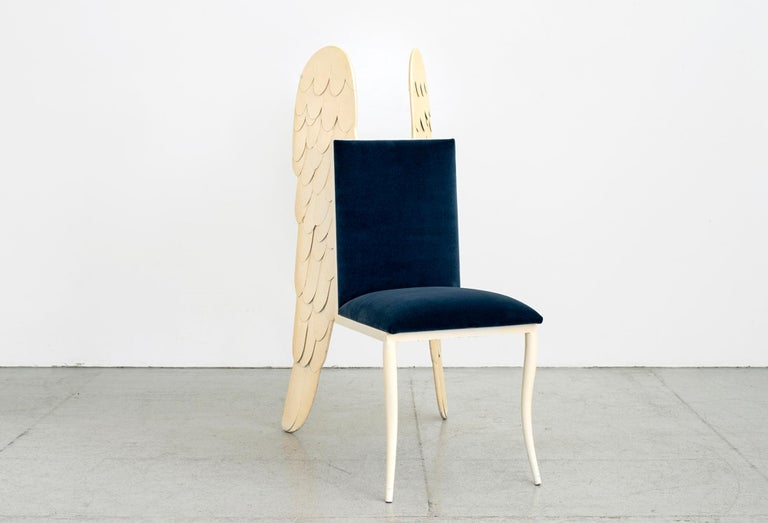 1980s Italian sculpture chair with carved angel wings and floating seat.