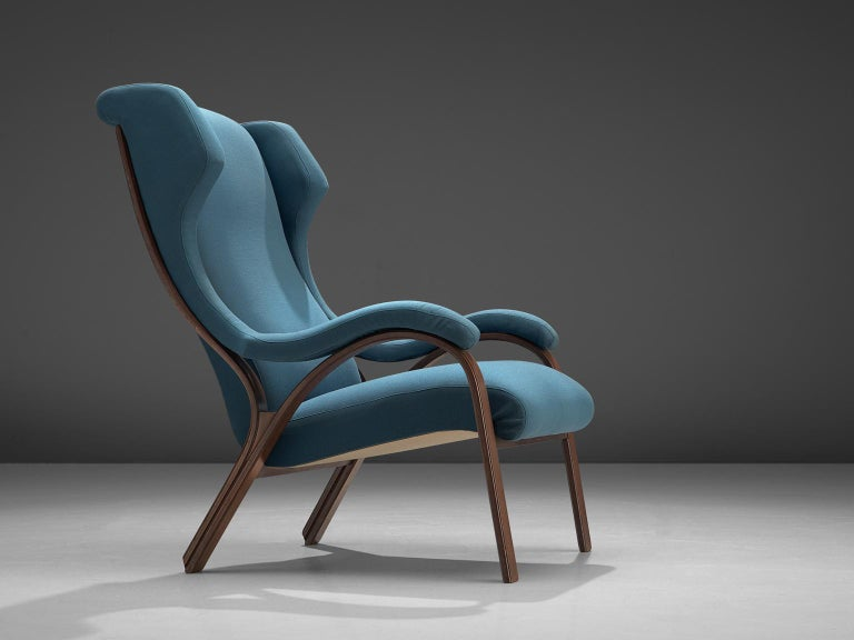 Cinova, easy chair, walnut and blue fabric, Italy, 1950s.