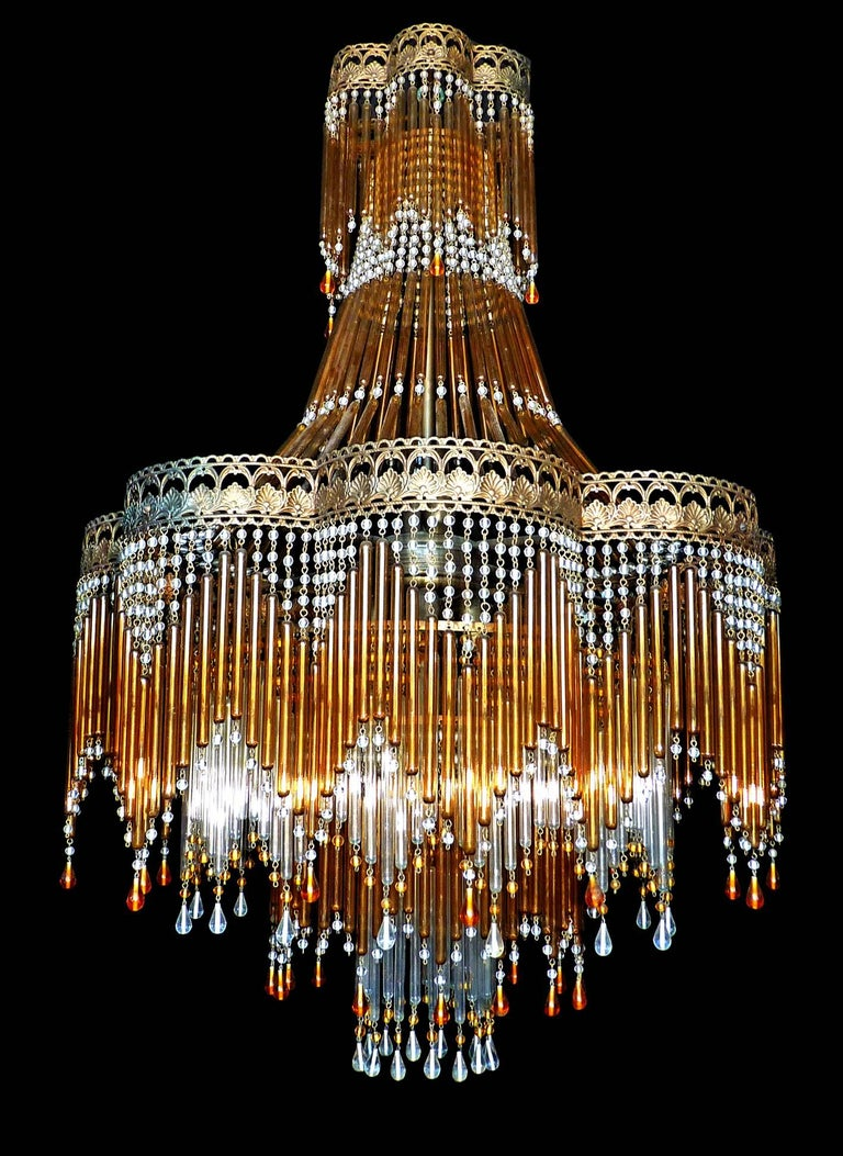 Fabulous Italian, midcentury in clear and amber Murano beaded glass Art Deco/Art Nouveau chandelier Measures: Diameter 52 cm Height 95 cm Seven light bulbs E14/ good working condition/European wiring. Age patina. Your item will be carefully
