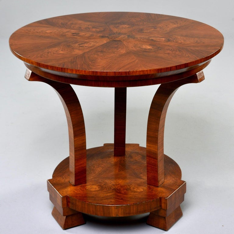 Italian center table with burled walnut veneer in bookmarked grain patterns, circa 1930s. Unknown maker. Very good vintage condition with scattered surface wear.