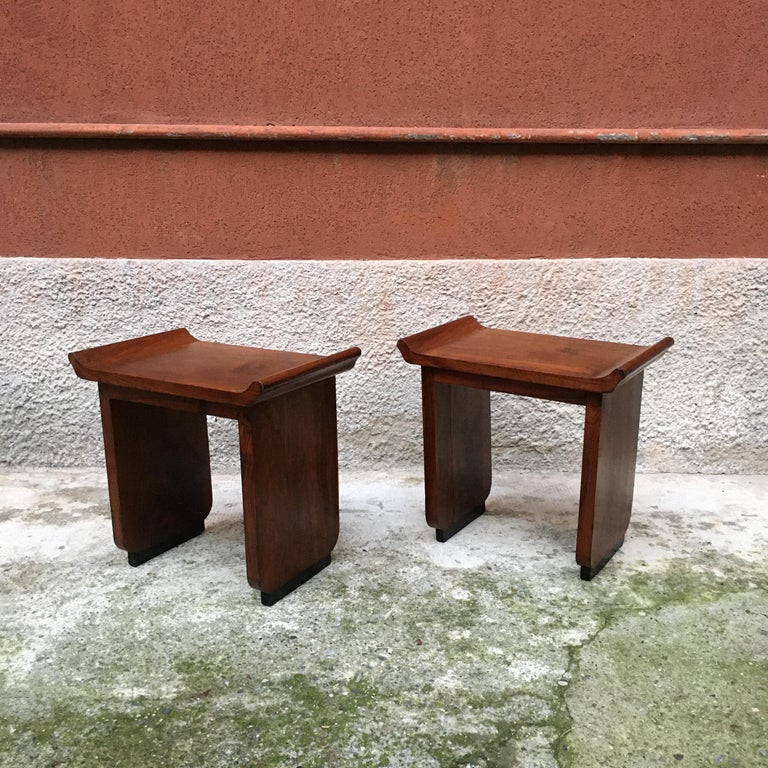 Italian Art Deco mahogany wood tray tables or stools, 1930s Pair of Art Deco tray tables or stools, in mahogany wood with black painted base of the legs and seat with curved corners Completely restored therefore in perfect condition circa 1930.