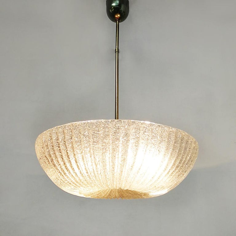 """Italian Art Deco Murano glass and brass chandelier, 1940s Superb Art Deco chandelier dating to the forties, provided of a frosted glass Murano lampshade, with external """"grit"""" finishing, in the middle small detail and rod brass finished. Double"""