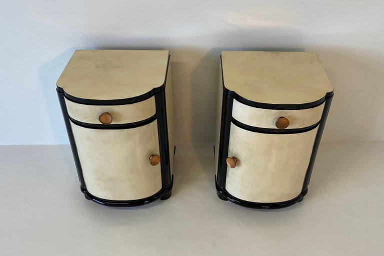 Rare Italian bedside tables from the 1930s completely covered in parchment.