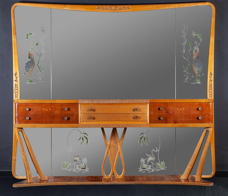 Elegant and rare Italian designed sideboard or console table handcrafted in exotic woods. Centre drawers framed with raised geometric marquetry. Beautifully executed by the artisan creating an understated piece attributed to Osvaldo Borsani, circa