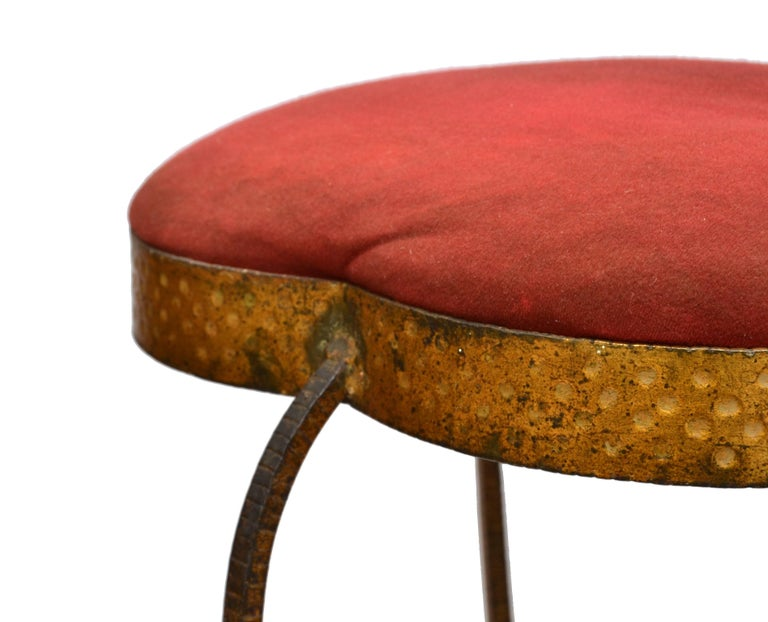 Graceful vanity stool made out of gold leaf hand hammered wrought iron with red upholstery by Pier Luigi Colli.