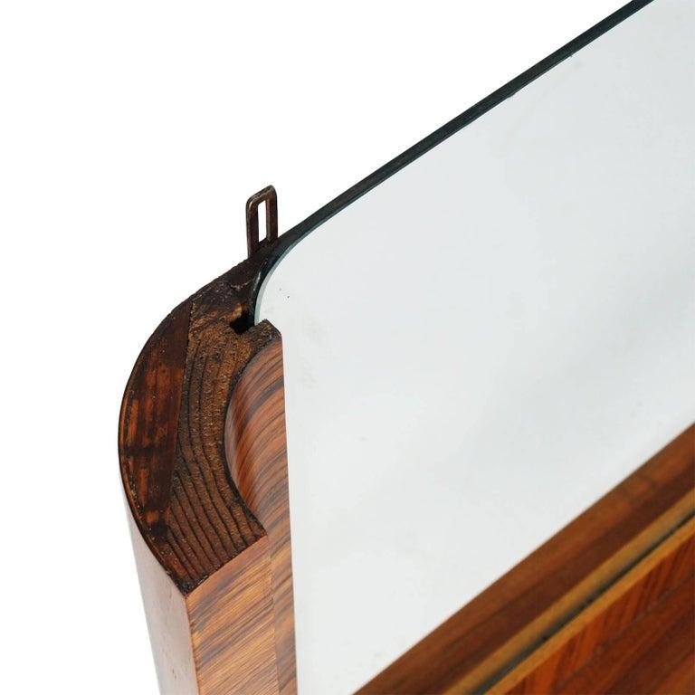 1930s Italian Art Decò wall mirror Osvaldo Borsani attributed in Macassar ebony polished to wax  Measures cm: H 74, W 121, D 11.