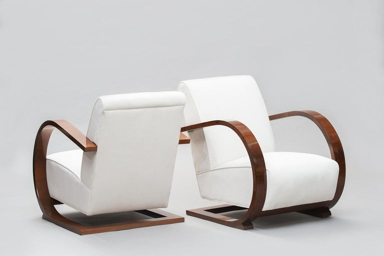 Italian Art Deco walnut venner armchairs reupholstered in ivory velveted fabric.
