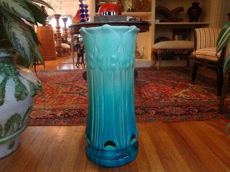Fantastic period Italian Art Nouveau glazed earthenware or Majolica umbrella stand. This gorgeous Italian umbrella stand is in beautiful shades of blue with a calla Lilly design.