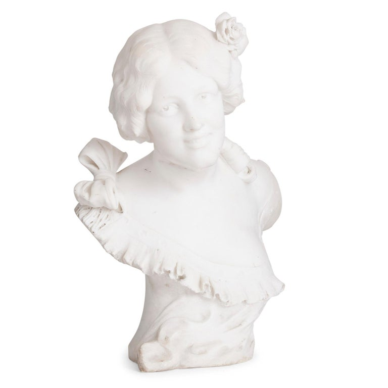 Italian Art Nouveau style sculpted marble bust by Pugi Italian, circa 1905 Measures: Height 57cm, width 41cm, depth 33cm  This fine marble bust of a young woman is designed in the distinctive Art Nouveau style. The young woman, who smiles