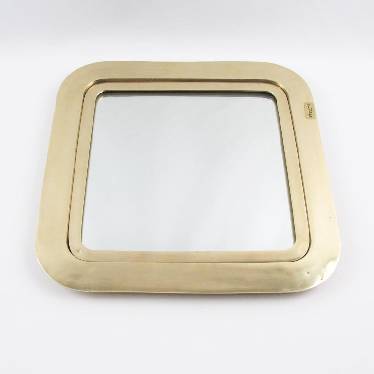 Impressive polished gilded bronze tray or platter by Italian artist Esa Fedrigolli. Heavy square shape with rounded corners, mirror insert with glass protection. Signed on front with brand sticker and also signed underside with engraved 'Esa