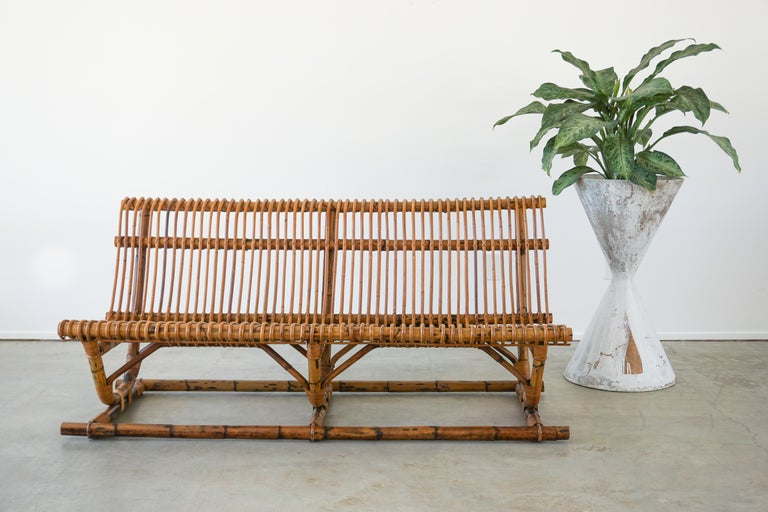 Fantastic Italian floating bamboo / rattan bench circa 1950's  Two available, priced individually.
