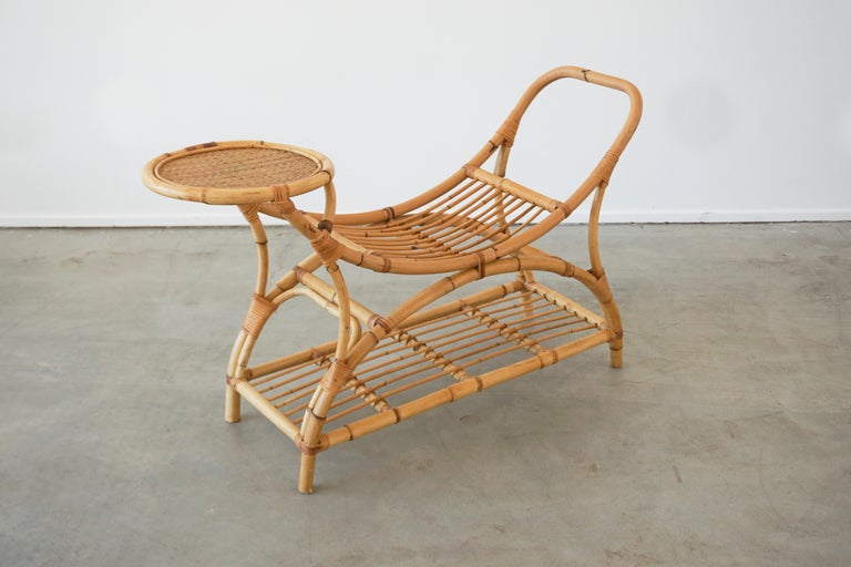 Pair of Italian bamboo benches - sculptural in shape with built in drink tables. And shelf. Perfect for summer by the pool! Priced as a pair.
