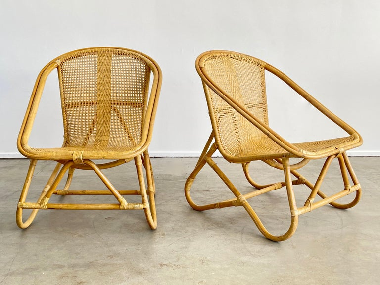 Wonderful pair of Italian bamboo and wicker chairs with great sculptural shape and profile. Intricate design to wicker - Set of 4 available, priced as a pair.