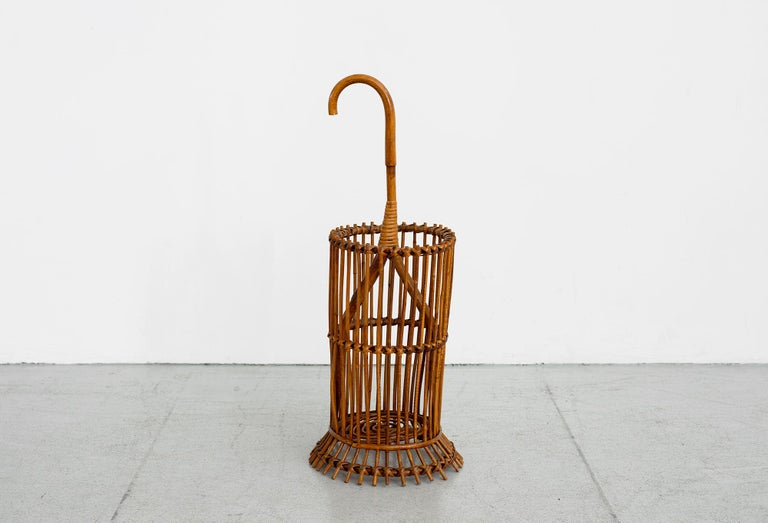 Great Italian bamboo rattan umbrella holder made in Italy in the style of Franco Albini.  Sculptural shape.