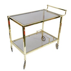 Italian Bar Cart on Two Levels and Smoked Glass, Italy 1970s, Gold-Plated Brass