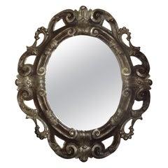 Italian Baroque Ebonized and Silver Gilt Mirror