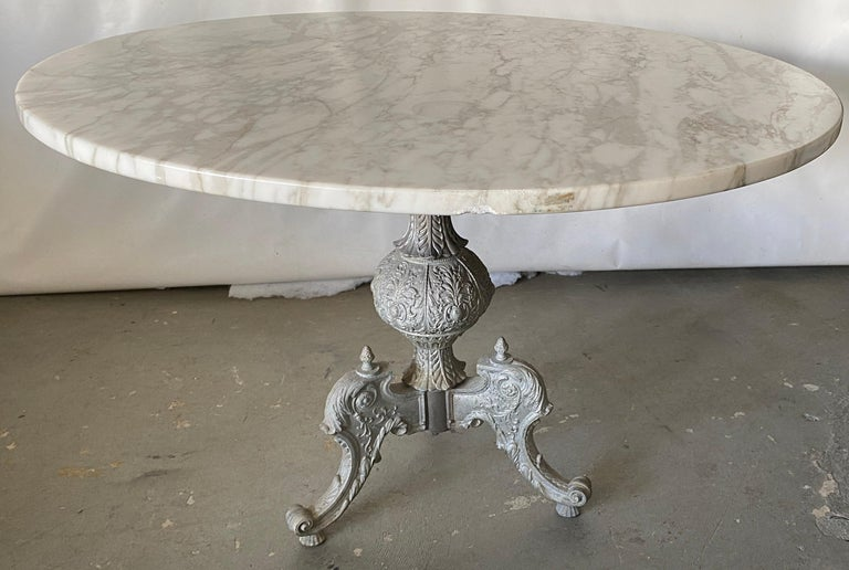 Highly stylish pewter colored metal base with center pedestal and tripod legs supporting a 40