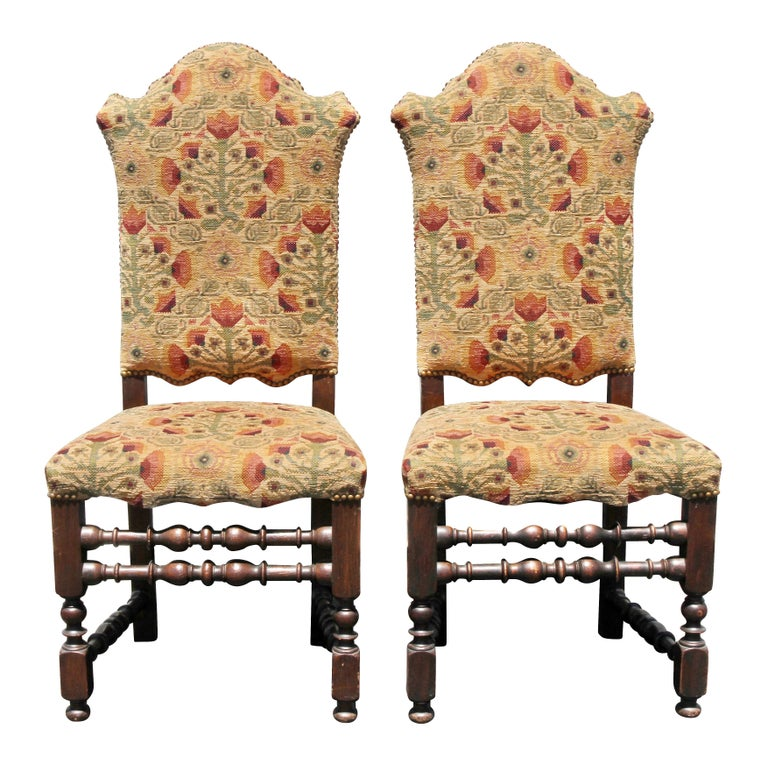 Each with arched tall backs and seats raised on turned legs with turned stretchers.