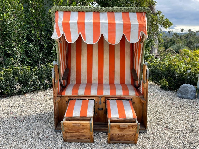 Incredible reclining deck chair / beach Cabana from the early 1900's Original green woven wicker and striped fabric Chair reclines and has pull out ottomans Drink trays that pop up from the side Great historic piece from the Italian Riviera at