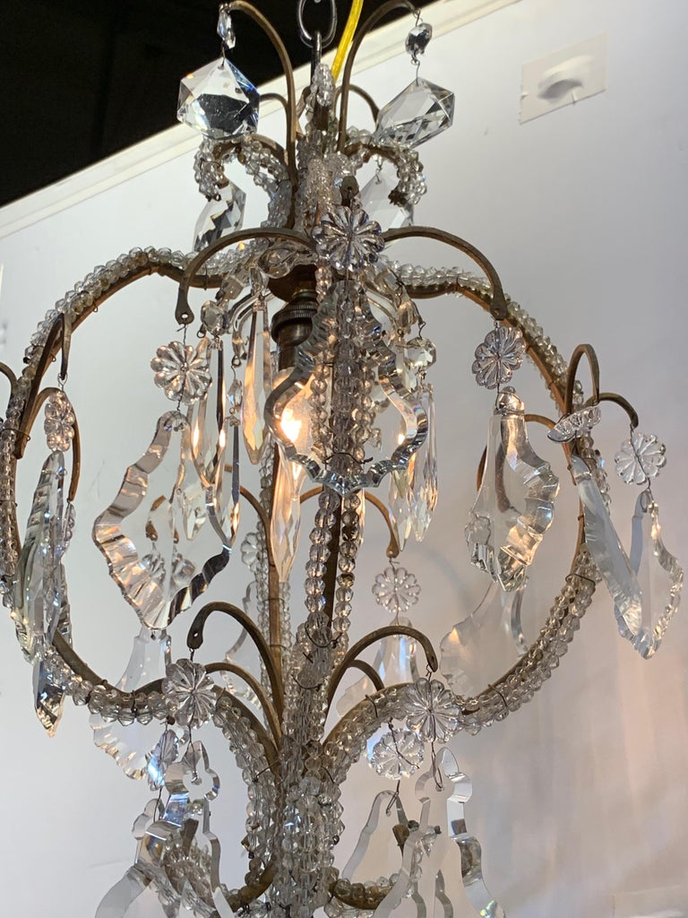 Elegant Italian beaded crystal single light chandelier. Lovely shape with beautiful dangling prisms. Makes a statement in a small space.