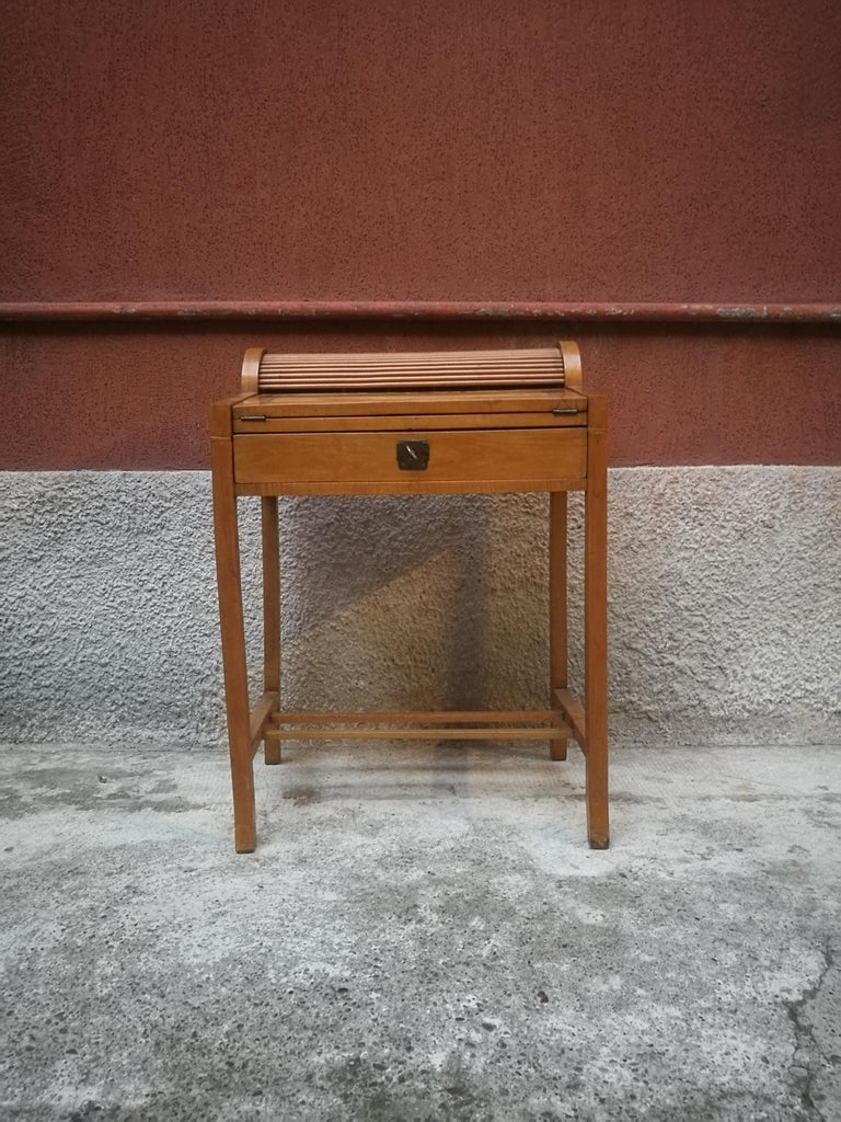 Italian beech entrance cabinet, 1950s. Entrance cabinet, equipped with drop-down shelf, which works as a writing desk. Equipped with a small shutter and drawers in the inside.
