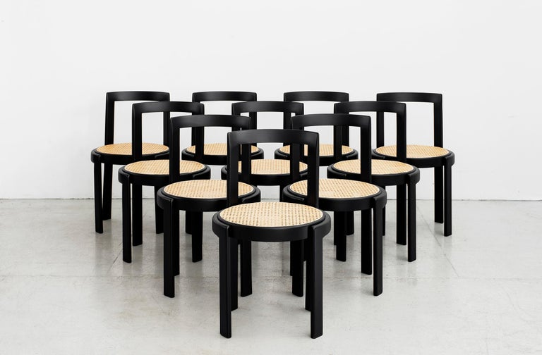Fantastic set of 10 Italian bentwood dining chairs Newly caned seat Refinished in black ebony finish.