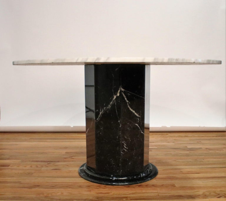 1970s pedestal table in the style of Ettore Sottsass in a black Italian marble hexagon shaped base with rounded bottom and a white 51