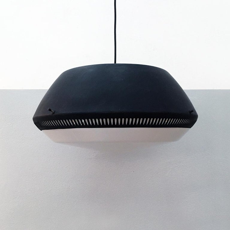 Italian black enameled metal chandelier by Gio Ponti for Greco, 1950s Black enameled metal chandelier with circular metal structure with decorative and functional perforated pattern along the entire perimeter and Plexiglas lampshade Coming from