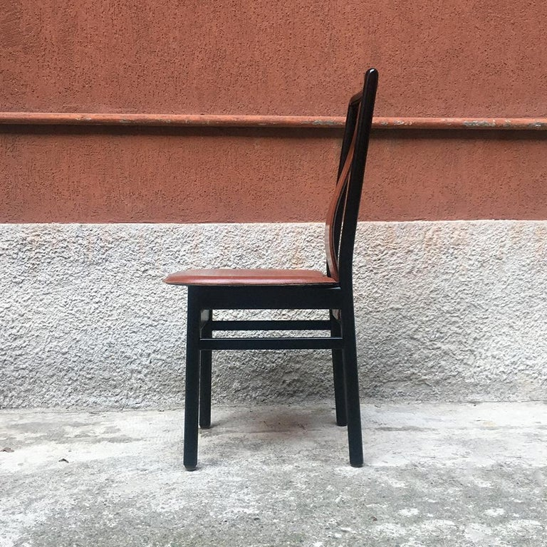 Italian black enameled wood and leather chair, 1980s Chair with structure in black enameled wood, seat and curved backrest in leather Very good condition.