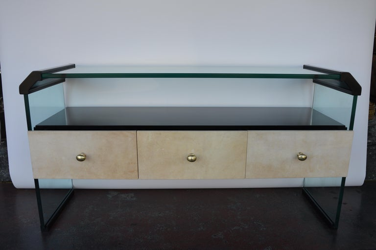 Italian Black Lacquer Console with Parchment drawers, brass handles and glass top and sides/legs. Italy, 1970's