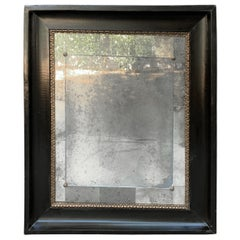 Italian Black Lacquered and Gilt Mercury Mirror