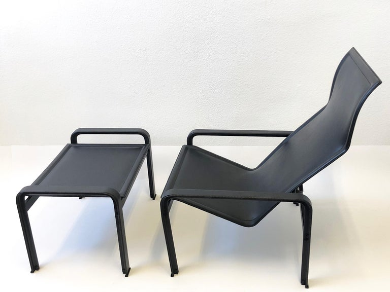 1970s Italian black leather lounge chair and ottoman by Matteo Grassi.  Constructed of metal frame covered with black thick saddle leather.  Newly restored, shows minor wear consistent with age.  Both chair and ottoman are marked Matteo Grassi.