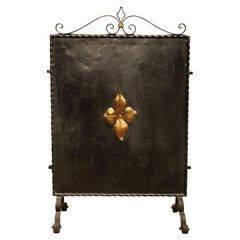 Italian Black Wrought Iron and Parcel-Gilt Freestanding Fire Place Screen