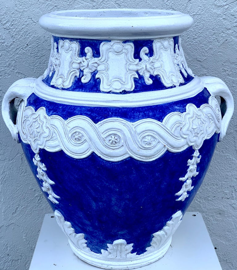 Italian blue and white Della Robbia style jardinière, Provenance, Celine Dion Of large scale the two handled urn with white appliqués on a Tuscan blue background. Can be used indoors or outside. The opening diameter is 16.5
