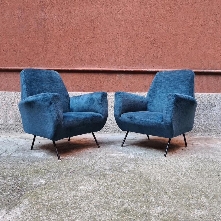 Italian blue velvet and metal, complete renewed armchairs, 1950s Couple of velvet armchairs dating to the fifties. Structure is complete renewed, new upholstery and new brilliant velvet, with black metal legs. Perfect condition. 75 x 86 x 90 H cm.