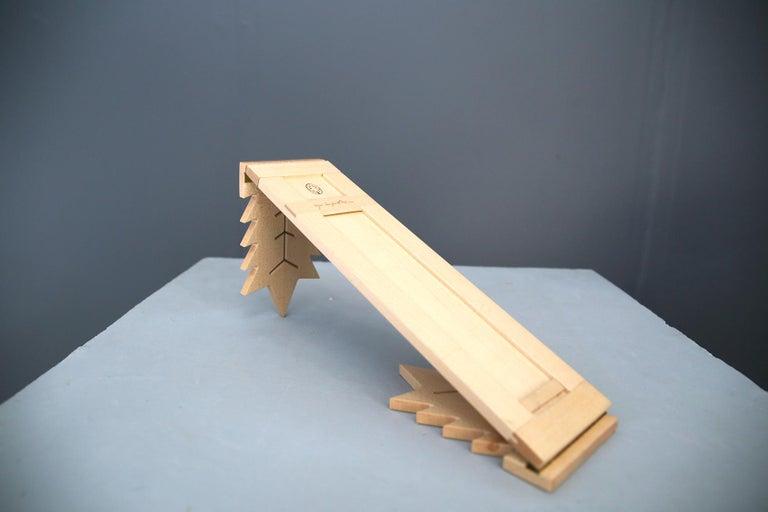 Beautiful book rack designed by Ugo La Pietra, and made by the cabinetmaker Pierliugi Ghianda around 1970. Manufacture