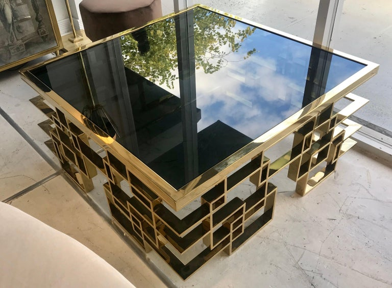 An Italian midcentury black glass and intricate glass cocktail table.