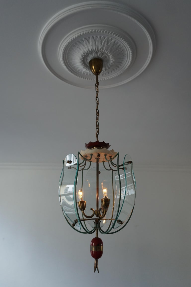 Beautiful elegant Italian 1950s ceiling lamp in brass and curved glass.  The light requires tree single E14 screw fit lightbulbs (60Watt max.) LED compatible.  Measures: Diameter 30 cm. Height fixture 50 cm. Total height 95 cm.