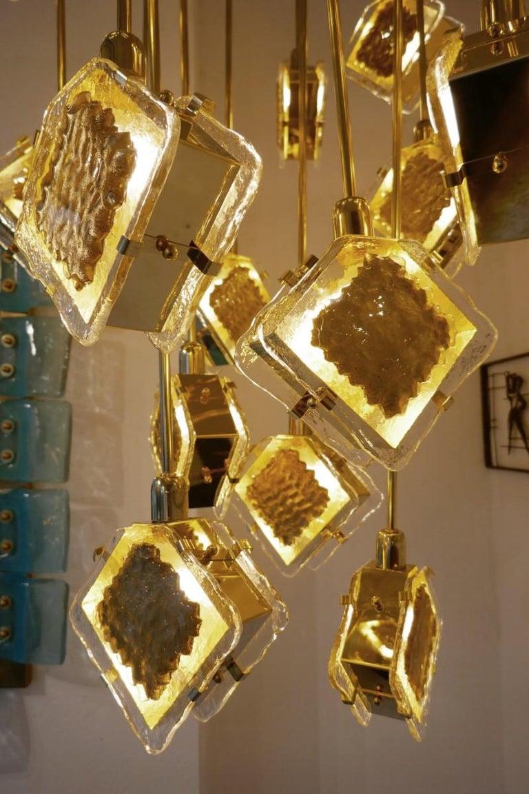 Italian brass and glass long chandelier.