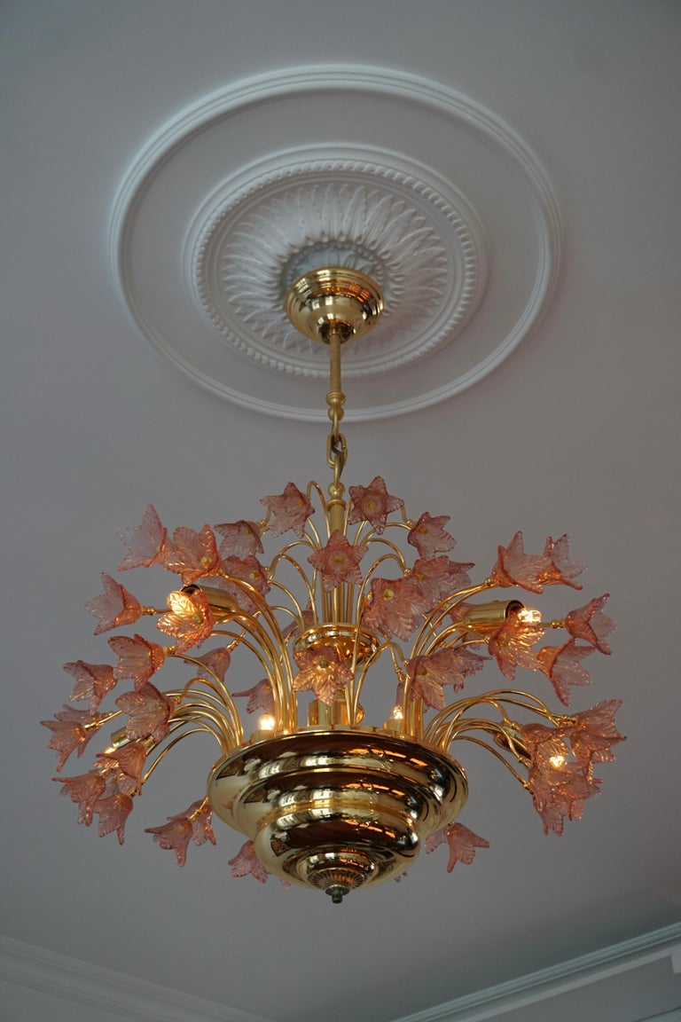 Elegant Italian brass and pink Murano glass chandelier.  The light requires 12 single E14 screw fit lightbulbs (40 Watt max.) LED compatible.  Measures: Diameter 60 cm. Height fixture 53 cm. Total height 80 cm.