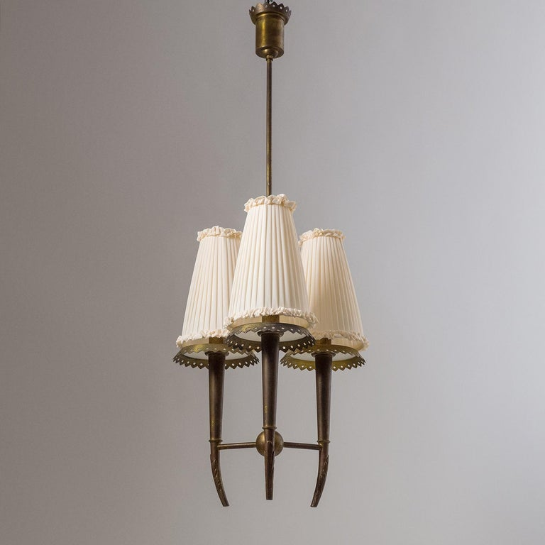 Rare 1930s Italian brass and glass chandelier attributed to Pietro Chiesa for Fontana Arte. Slender, nicely constructed brass body with age-related patina and new custom shades. Three original brass and ceramic E14 sockets with new wiring. Body
