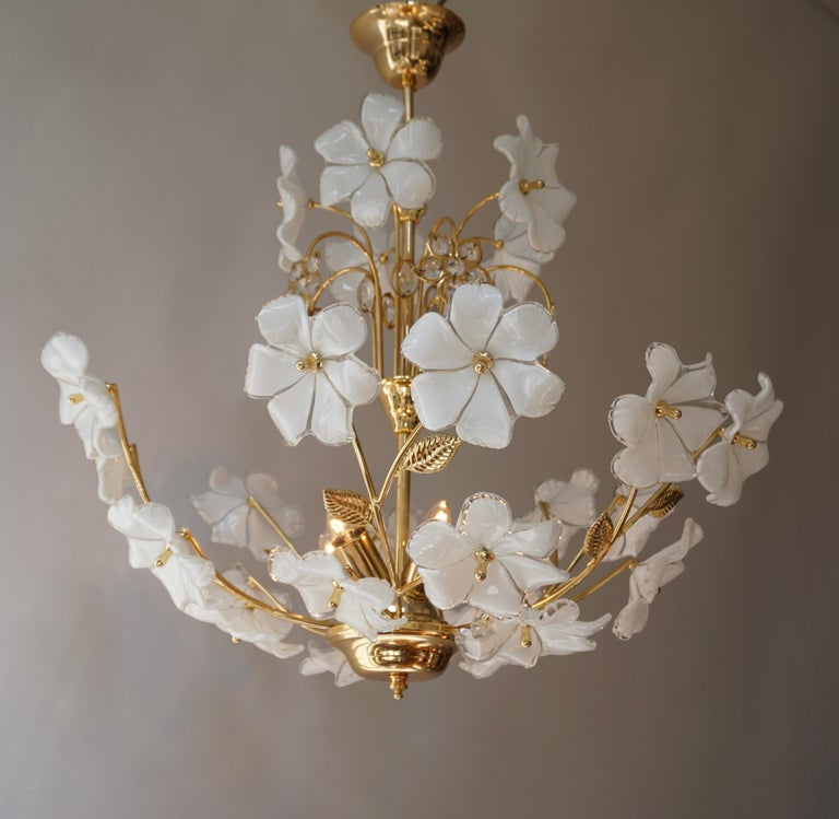 Large Italian brass chandelier with white Murano glass and crystal flowers.