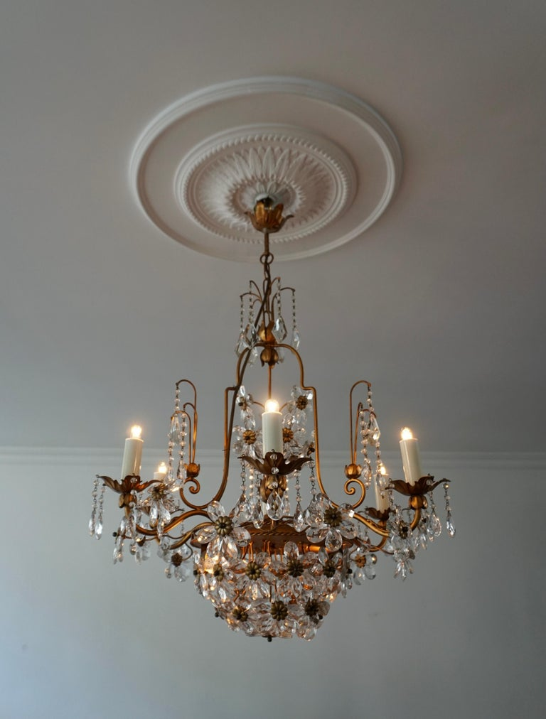 Elegant Italian chandelier is brass and crystal flowers.  The light requires eight single E14 screw fit lightbulbs (60Watt max.) LED compatible.  Measures: Diameter 63 cm. Height fixture 67 cm. Total height 87 cm.